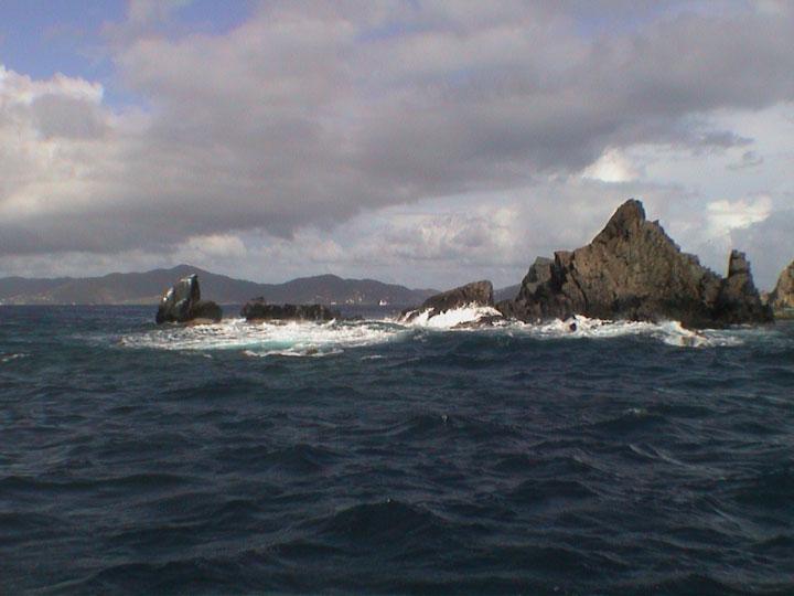dangerous rocks on the shoreline